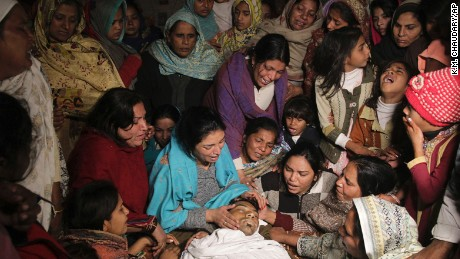 Pakistani women mourn the death of their family member in Toba Tek Singh, Pakistan, Wednesday, Dec 28, 2016. Local police officer Atif Imran Qureshi said that over two dozens people were killed and many transported to hospitals after they consumed contaminated alcohol during the Christmas holiday. (AP PhotoK.M. Chaudhry)