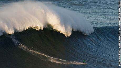 NAZARE, PORTUGAL - DECEMBER 17:  British surfer Andrew Cotton rides a big wave at Praia do Norte on December 17, 2016 in Nazare, Portugal. Nazare's giant waves are increasingly attracting surfers from around the world, as it becomes part of the World Surf League Big Wave Tour.  (Photo by Pablo Blazquez Dominguez/Getty Images)