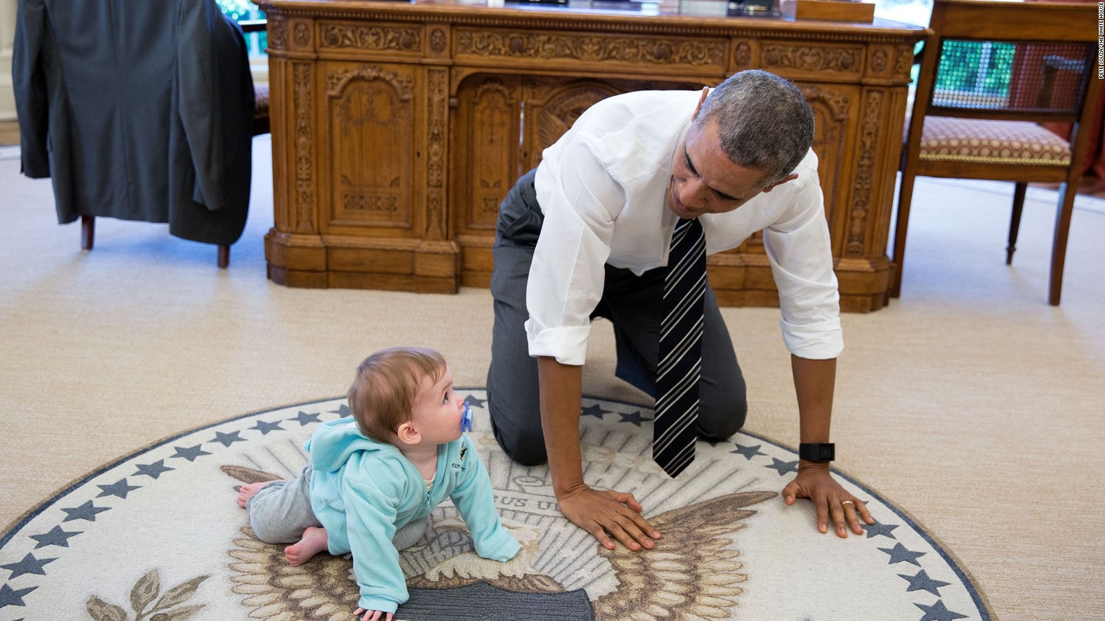 Image result for Obama informa on carpet white house with baby
