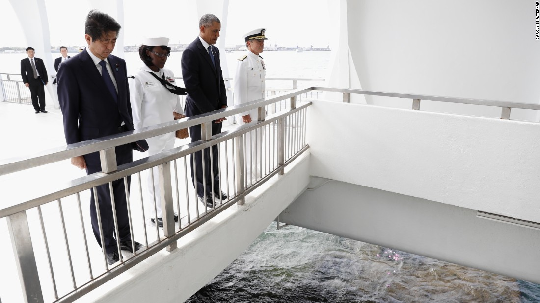 "President Barack Obama and Japanese Prime Minister Shinzo Abe pause after tossing flower petals into the Wishing Well at the USS Arizona Memorial in Joint Base Pearl Harbor-Hickam, Hawaii, on Tuesday, December 27. This was part of a <a href=""http://www.cnn.com/2016/12/27/politics/shinzo-abe-pearl-harbor-obama/index.html"" target=""_blank"">ceremony to honor those killed</a> in the Japanese attack on the naval harbor 75 years ago."