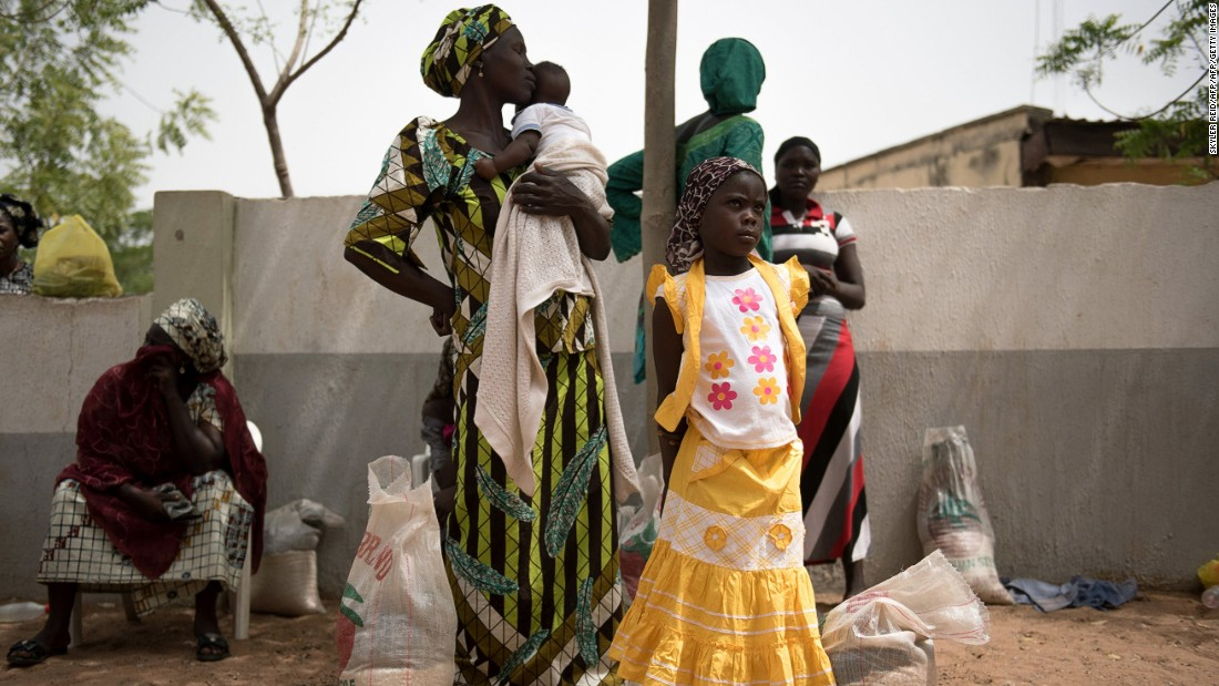 In Nigeria, conflict and violence caused by the Boko Haram insurgency make up more than 90 percent of displacements, according to IOM. Pictured: displaced Nigerians at a distribution center.