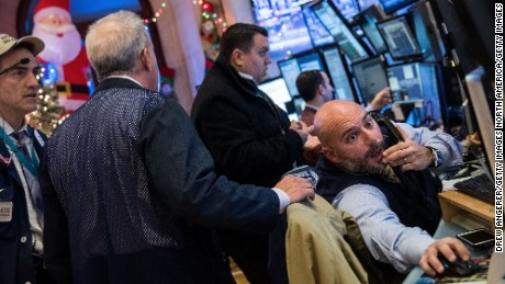 NEW YORK, NY - DECEMBER 20: Traders and financial professional work on the floor of the New York Stock Exchange (NYSE), December 20, 2016 in New York City. Since Nov. 8, the Dow has surged more than 8 percent and has posted 17 record closes as it continues to approach the 20,000 mark. (Photo by Drew Angerer/Getty Images)