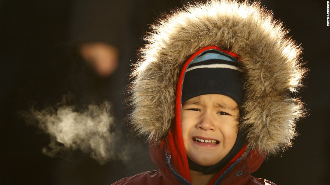 Theo Bradeen, age 5, reacts to the cold after a ferry ride from his home on Peaks Island to Portland, Maine, on Friday, December 16. The temperature in Portland dropped to minus 2 degrees Fahrenheit with a wind chill of minus 25.