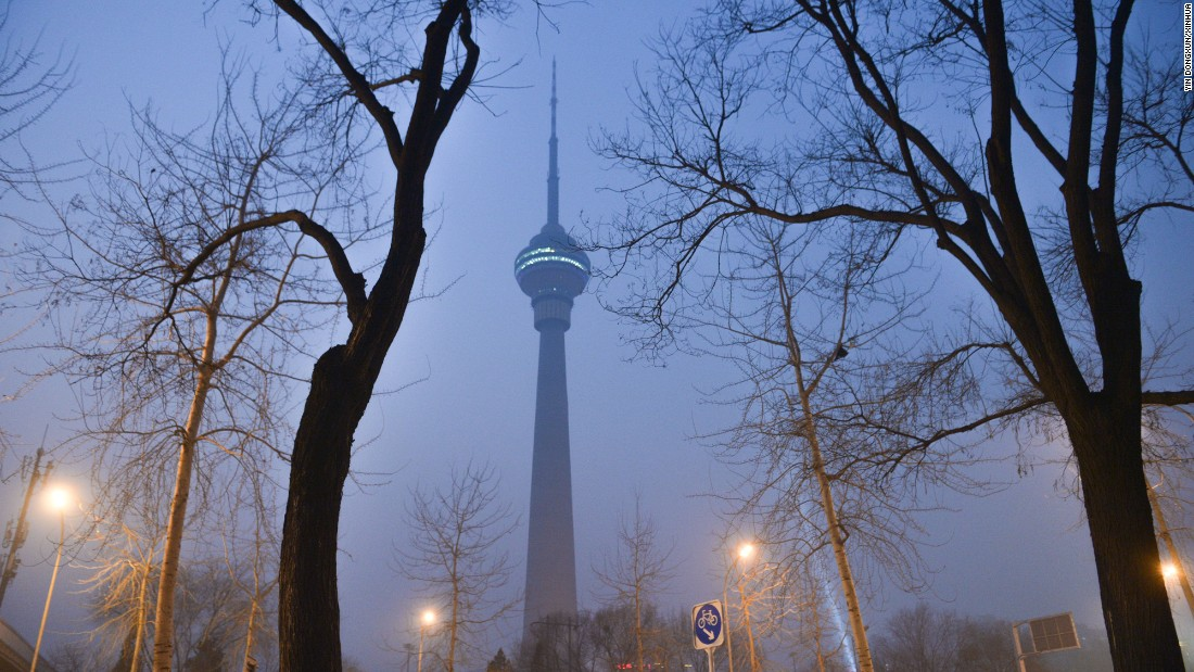 The Central TV Tower in Beijing, China, is seen through thick smog on Saturday, December 17. The city was under red alert because of the amount of smog in the air.