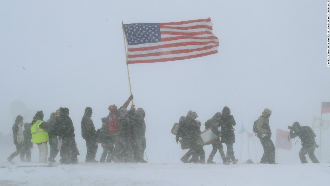 "Despite blizzard conditions, <a href=""http://www.cnn.com/2016/12/04/us/dakota-access-pipeline-protests-veterans/"" target=""_blank"">military veterans march in support </a>of the ""water protectors"" at Oceti Sakowin Camp on the edge of the Standing Rock Sioux Reservation in Cannon Ball, North Dakota, on Monday, December 5."