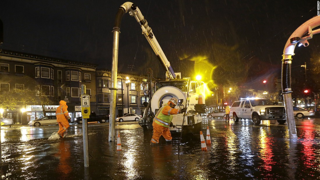 A crew works on a flooded intersection in San Francisco, California, on Thursday, December 15.