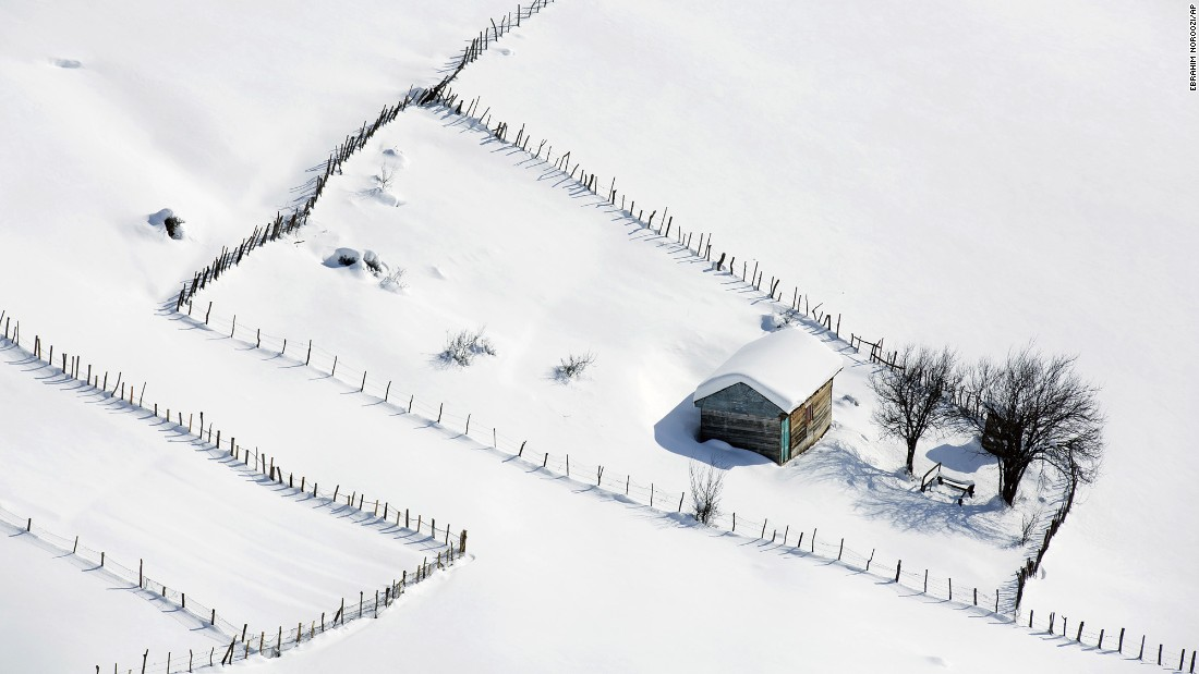 A wooden cottage is covered in snow in the Talesh Mountains, close to the Caspian Sea, in Iran, on Tuesday, December 20. Villagers leave their wooden cottages in the cold season because of heavy snowfall, returning in late spring to host tourists.
