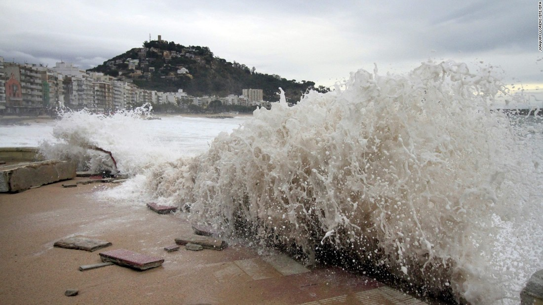 Waves crash against the promenade in Blanes, Spain, on Tuesday, December 20.