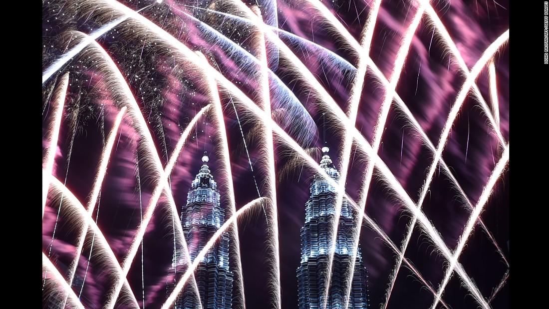 Fireworks illuminate the sky near the Petronas Twin Towers in Kuala Lumpur, Malaysia.