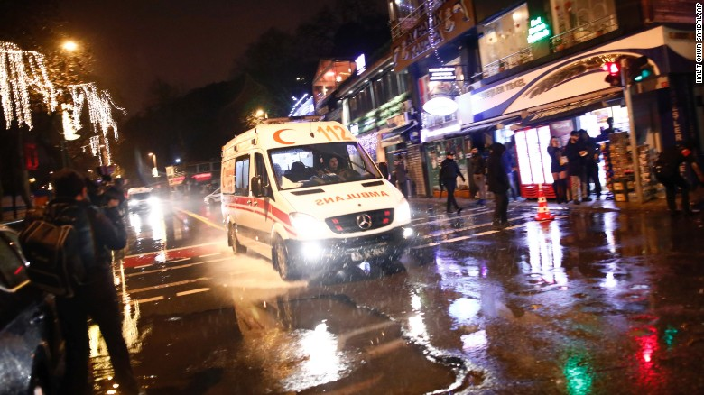 An ambulance rushes from the scene of an attack in Istanbul, Turkey, on Sunday, January 1. A popular nightclub in Istanbul was attacked shortly after midnight.