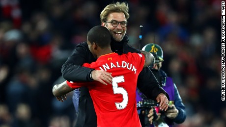 LIVERPOOL, ENGLAND - DECEMBER 31:  Georginio Wijnaldum of Liverpool and Jurgen Klopp, Manager of Liverpool celebrate victory during the Premier League match between Liverpool and Manchester City at Anfield on December 31, 2016 in Liverpool, England.  (Photo by Clive Brunskill/Getty Images)