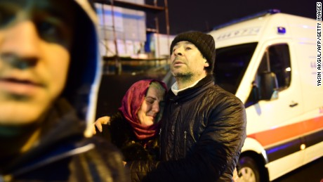 People react at the site of an armed attack January 1, 2017 in Istanbul. At least two people were killed in an armed attack Saturday on an Istanbul nightclub where people were celebrating the New Year, Turkish television reports said. / AFP / YASIN AKGUL        (Photo credit should read YASIN AKGUL/AFP/Getty Images)