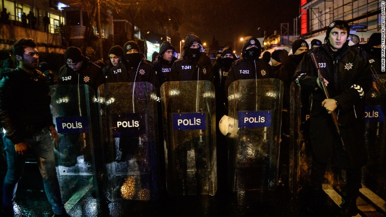 Turkish riot police officers stand guard.