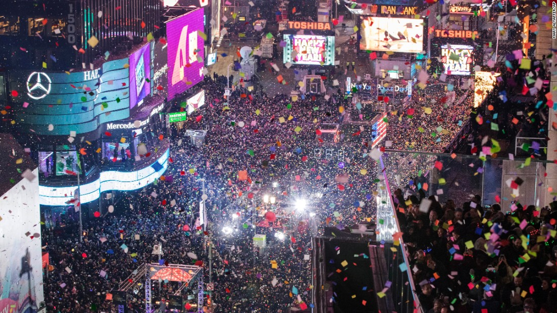 People celebrate 2017 as confetti flies over Times Square in New York City on Sunday, January 1.