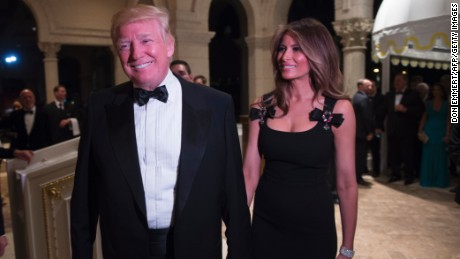 President-elect Donald Trump arrives with his wife, Melania, for a New Year's Eve party December 31, 2016 at Mar-a-Lago in Palm Beach, Florida.