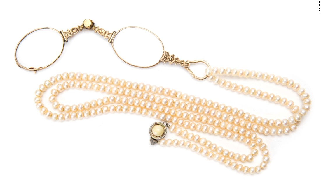 This folding lorgnette, embellished with pearls, comes from the early-1900s in Central Europe.