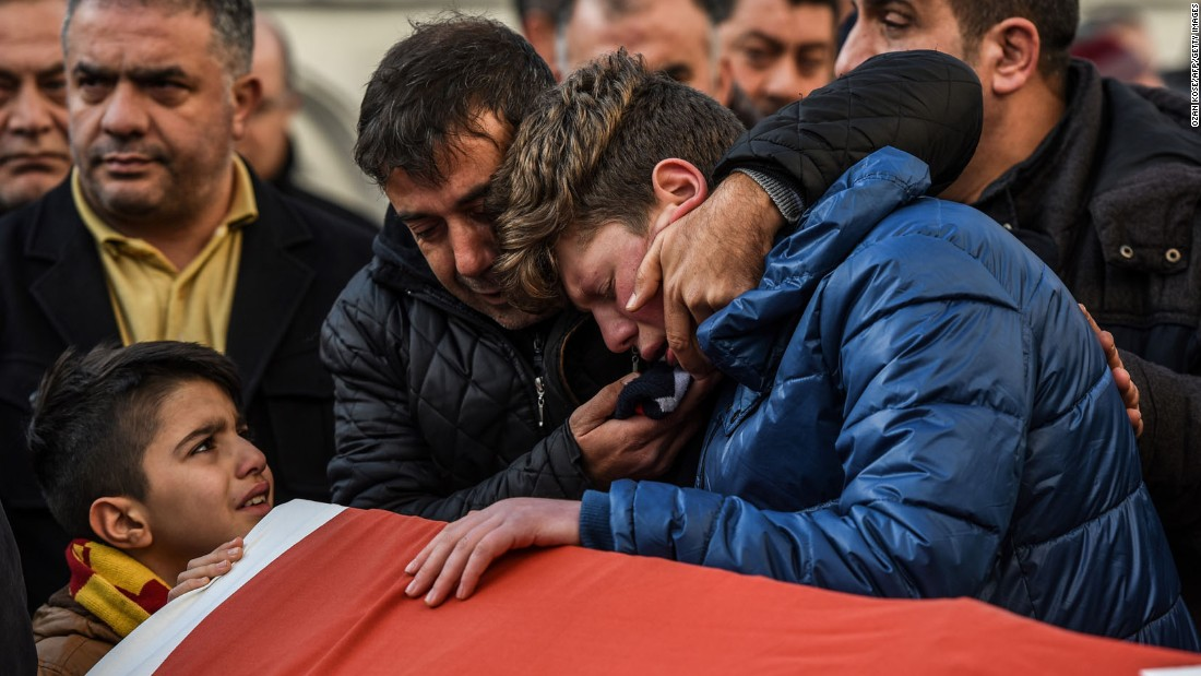Relatives of Ayhan Arik, one of the victims of the attack, cry during a funeral ceremony in Istanbul on January 1.