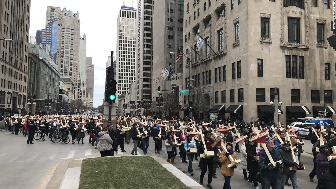 On New Year's Eve, people carried nearly 800 wooden crosses bearing the names of those killed in Chicago in 2016.