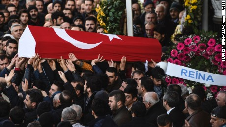 People carry the coffin of Yunus Gormek, 23, one of the victims of the Reina night club attack, during his funeral ceremony on January 2, 2017 in Istanbul.   The Islamic State jihadist group on January 2, 2017 claimed the shooting rampage inside a glamorous Istanbul nightclub on New Year's night that killed 39 people, as police hunted the attacker who remains on the run. With foreigners making up the majority of those killed in Sunday's attack, families were due to reclaim the bodies of more than two dozen non-Turkish and mainly Arab victims.  / AFP / BULENT KILIC        (Photo credit should read BULENT KILIC/AFP/Getty Images)