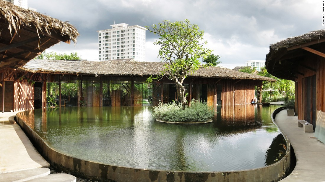 The T3 team designed its own Green Office building in downtown Saigon using bioclimatic principles. The architecture firm enjoys wood fixtures, a roof made of palm leaves, overhanging eaves to protect from the city's blazing sun, and a tranquil pond as a center piece.