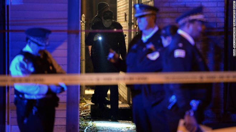Police investigate a multiple homicide scene a 8048 S. South Shore Dr. that left 3 dead and 1 wounded Wednesday, Nov. 3, 2016 in Chicago. (Brian Jackson/Chicago Tribune/TNS via Getty Images)