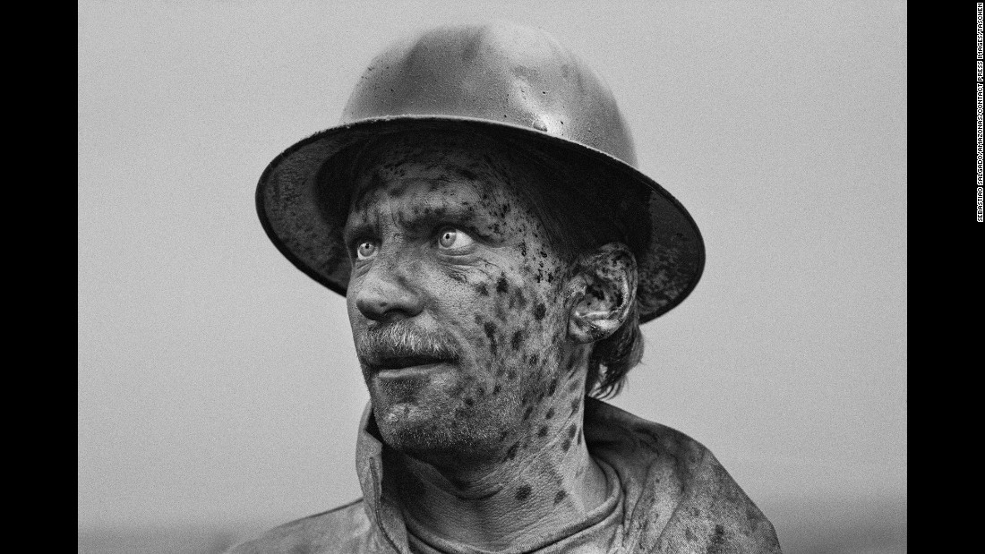"Sebastiao Salgado photographed the workers, their faces stained with oil. His latest book, <a href=""https://www.taschen.com/pages/en/catalogue/photography/all/05314/facts.sebastio_salgado_kuwait_a_desert_on_fire.htm"" target=""_blank"">""Kuwait: A Desert on Fire,""</a> was recently published by Taschen."