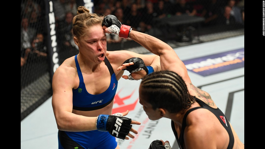 "UFC bantamweight champion Amanda Nunes punches Ronda Rousey during their title fight in Las Vegas on Friday, December 30. <a href=""http://www.cnn.com/2016/12/31/sport/ronda-rousey-amanda-nunes-ufc-207-ko/index.html"" target=""_blank"">Nunes demolished Rousey,</a> defeating the former champ in 48 seconds."