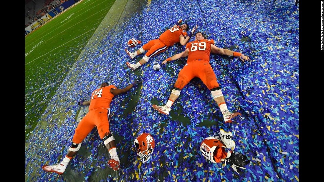 "Clemson offensive linemen -- from left, John Simpson, Gage Cervenka and Maverick Morris -- play in confetti after the Tigers won the Fiesta Bowl on Saturday, December 31. Clemson crushed Ohio State 31-0 in what was a semifinal of the College Football Playoff. The Tigers <a href=""http://www.cnn.com/2016/12/31/sport/college-football-playoff-peach-bowl-fiesta-bowl-semifinals/index.html"" target=""_blank"">will face Alabama</a> in the championship game -- a rematch of <a href=""http://www.cnn.com/2016/01/11/us/ncaa-football-national-championship/"" target=""_blank"">last year's finale,</a> which Alabama won 45-40."