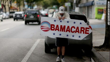 MIAMI, FL - FEBRUARY 05: Pedro Rojas holds a sign directing people to an insurance company where they can sign up for the Affordable Care Act, also known as Obamacare, before the February 15th deadline on February 5, 2015 in Miami, Florida. Numbers released by the government show that the Miami-Fort Lauderdale-West Palm Beach metropolitan area has signed up 637,514 consumers so far since open enrollment began on Nov. 15, which is more than twice as many as the next large metropolitan area, Atlanta, Georgia.