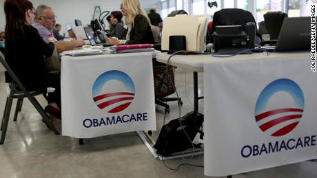 MIAMI, FL - FEBRUARY 05: Aymara Marchante (L) and Wiktor Garcia sit with Maria Elena Santa Coloma, an insurance advisor with UniVista Insurance company, as they sign up for the Affordable Care Act, also known as Obamacare, before the February 15th deadline on February 5, 2015 in Miami, Florida.