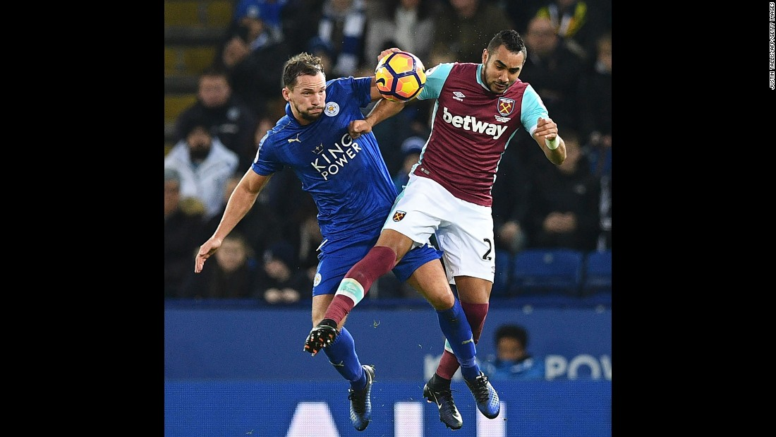 Leicester City's Danny Drinkwater, left, collides with West Ham's Dimitri Payet during a Premier League match in Leicester, England, on Saturday, December 31.