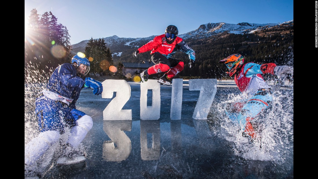 "Athletes who compete in downhill ice cross -- specifically the Red Bull Crashed Ice series -- skate on black ice in Lenzerheide, Switzerland, on Friday, December 30. The photo shoot was held on Lake Heid, which had a clear-glass look because there hadn't been any snow. <a href=""http://www.cnn.com/2016/12/26/sport/gallery/what-a-shot-sports-1227/index.html"" target=""_blank"">See 32 amazing sports photos from last week</a>"