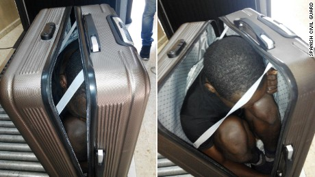 "Photos taken by Spanish Civil Guard on December 30, 2016 show a rescued 19-year-old migrant from Gabon who attempted to cross into Ceuta inside a suitcase. The man was in immediate need of medical attention due to the lack of oxygen inside the suitcase. Authorities arrested the 22-year-old woman who was carrying the suitcase. The statement by the country's Civil Guard says officials decided to ask her to open her suitcase after they noticed she was carrying it on top of a trolley. Authorities add the woman showed ""evasive attitude while going through the established controls and nervousness"" while speaking to the agents."