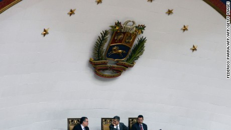 The president of the Venezuelan National Assembly, Henry Ramos Allup (C), speaks with first vice president Enrique Marquez (L) next to second vice-president Simon Calzadilla (R) during a congress session in Caracas on March 3, 2016. Venezuela's opposition-controlled legislature will ask the Organization of American States to mediate in its standoff with President Nicolas Maduro and the judiciary. AFP PHOTO/FEDERICO PARRA / AFP / FEDERICO PARRA        (Photo credit should read FEDERICO PARRA/AFP/Getty Images)