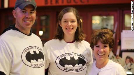 Rosemary Heath, right, and the Creeds have become close friends. They are seen here wearing Batman T-shirts, George Heath's favorite superhero, at a fundraiser in his name.
