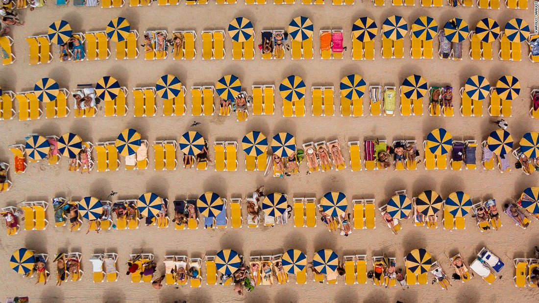 <strong>Summer camp: </strong>Umbrellas and beach-goers reduced to miniature make this picture of Playa de Amadores, Gran Canaria, one of the top 20 drone photos of 2016.