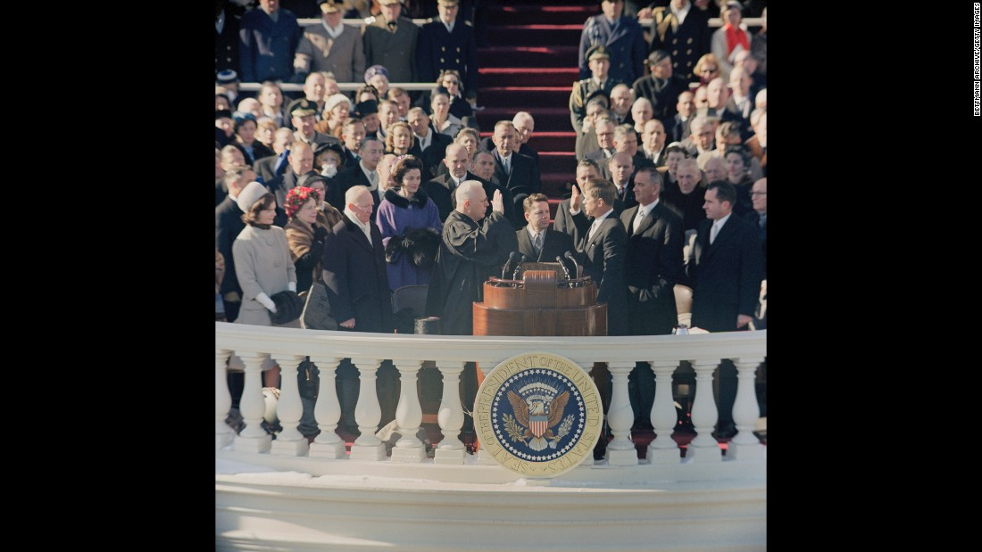 John F. Kennedy is sworn in by Chief Justice Earl Warren in 1961. Kennedy, at 43, was the youngest ever to be elected president. This was the first inauguration ceremony to be televised in color.