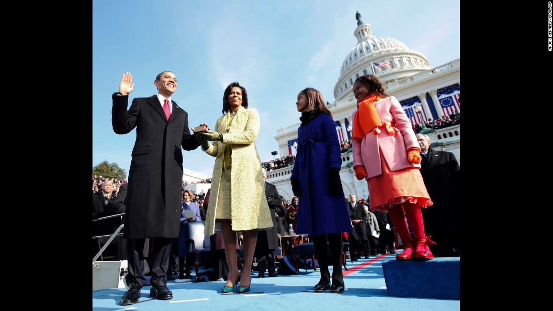 Barack Obama is sworn in as the 44th president of the United States in 2009. His wife, Michelle, is holding the Bible as he takes the oath of office, and they are joined by their daughters, Malia and Sasha. An estimated 1.5 million people attended the inauguration as Obama became the nation's first African-American president.