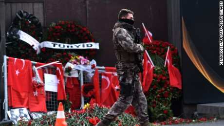 A Turkish police officer patrols in front of the Reina nightclub three days after a gunman killed 39 people at the nighclub on New Year's Day.