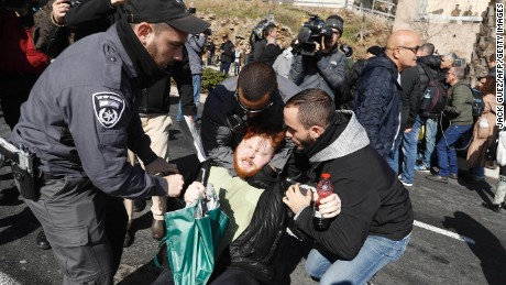 Police detain an Azaria supporter protesting Wednesday outside the Ministry of Defense in Tel Aviv.