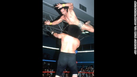 "Jimmy ""Superfly"" Snuka performing his signature ""Superfly Splash"" move in the wrestling ring."