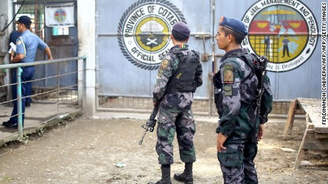 Armed police stand guard at the gates of the district jail, where more than a hundred inmates escaped from, in the town of Kidapawan, in southern island of Mindanao on January 4, 2017. More than 150 inmates of the southern Philippine jail escaped when suspected Muslim rebels stormed the dilapidated facility in a pre-dawn raid on Janaury 4, killing one guard, authorities said. / AFP / FERDINANDH CABRERA        (Photo credit should read FERDINANDH CABRERA/AFP/Getty Images)