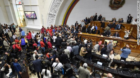 "Opposition deputies argue with government representatives during a National Assembly special session to vote to open a political trial against President Nicolas Maduro, in Caracas, on October 25, 2016. A majority of lawmakers voted in favor of a motion to launch a ""political and criminal trial"" against President Nicolas Maduro after he blocked their drive for a referendum on removing him. / AFP / JUAN BARRETO        (Photo credit should read JUAN BARRETO/AFP/Getty Images)"