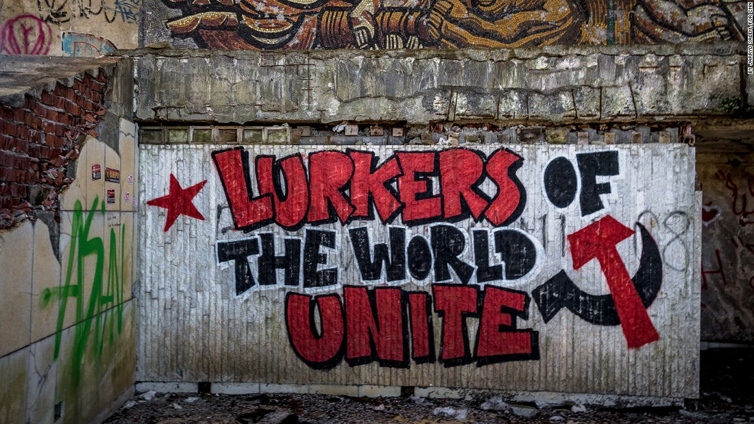"<strong>""Lurkers of the world unite"": </strong>The popular communist slogan was reworked in this graffiti, which has now become a famous piece of art inside the Buzludzha Monument.<br />"