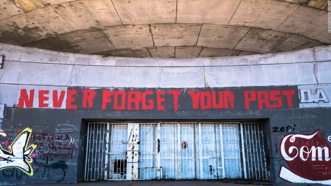 "<strong>Graffiti gate: </strong>Above the locked entrance, graffiti declaring ""never forget your past"" is a somber reminder of the Balkans' recent history. <br />"