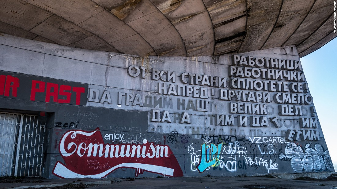 <strong>'Enjoy Communism': </strong>The original Cyrillic letters are crumbling, but new slogans are being added all the time.