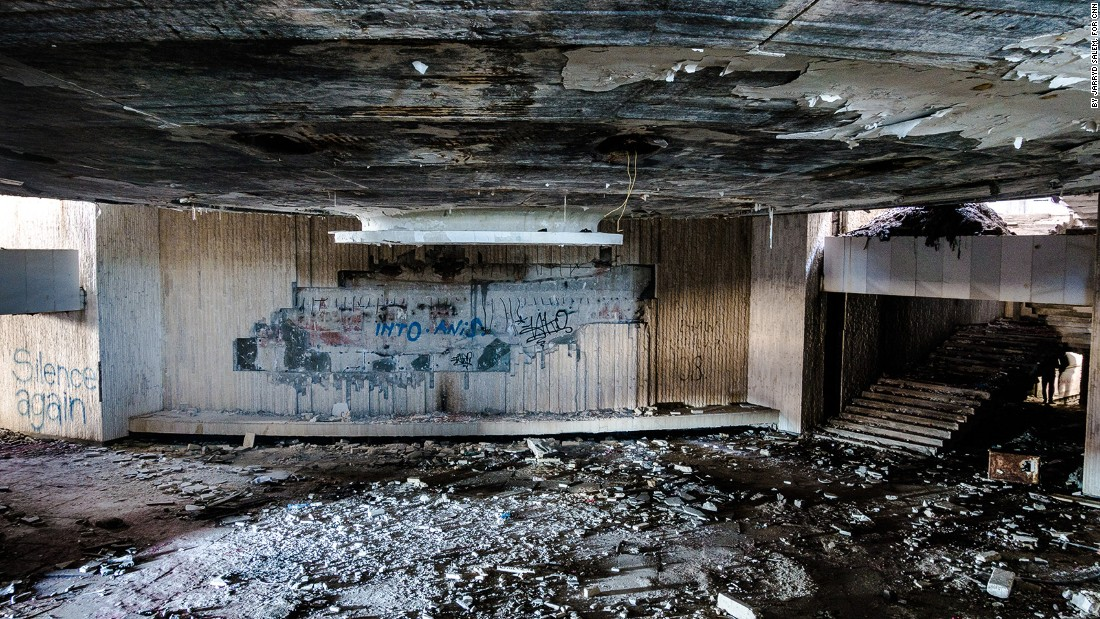 <strong>Way in:</strong> This is the first glimpse of the Buzludzha Monument's interior when crawling through the concrete hole through which intruders can gain access. Debris is scattered throughout the entire ruin.