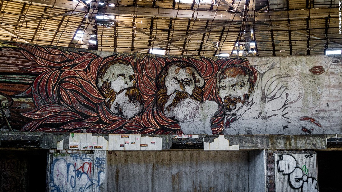 <strong>Communist tributes: </strong>Mosaic images of Engels, Marx and Lenin watch over the hall.