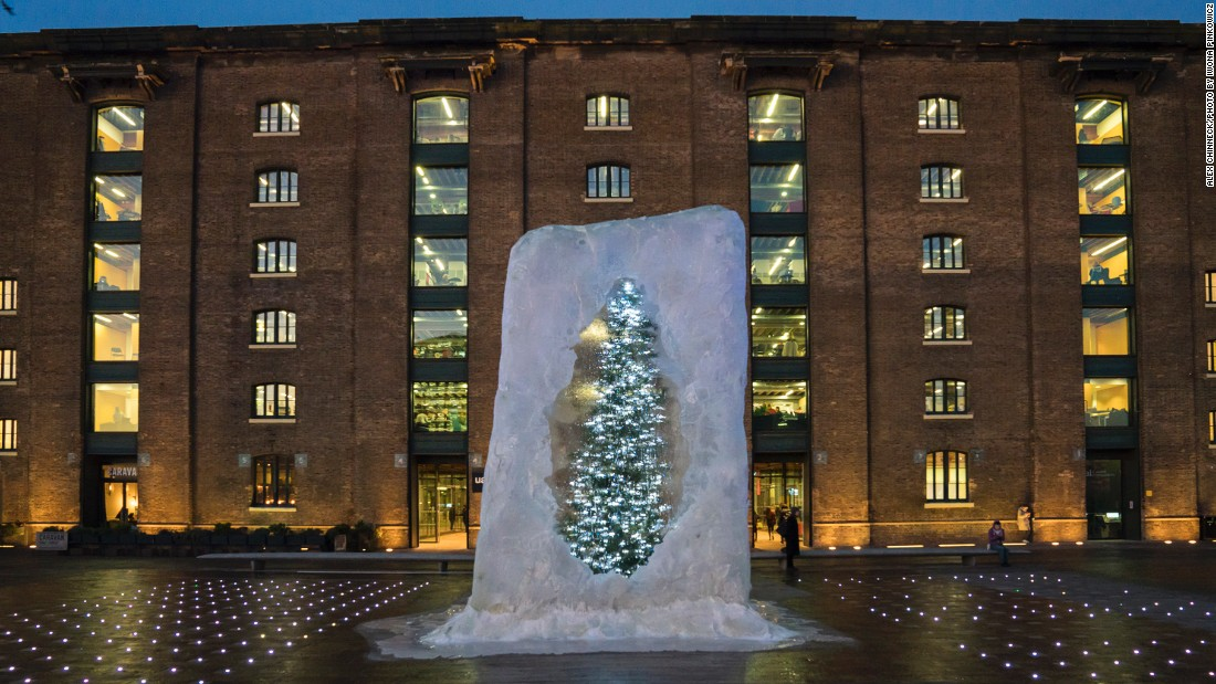 British artist Alex Chinneck froze a 17-ft-tall Christmas tree inside a cube of ice. The tree is decorated with 1,200 lights.