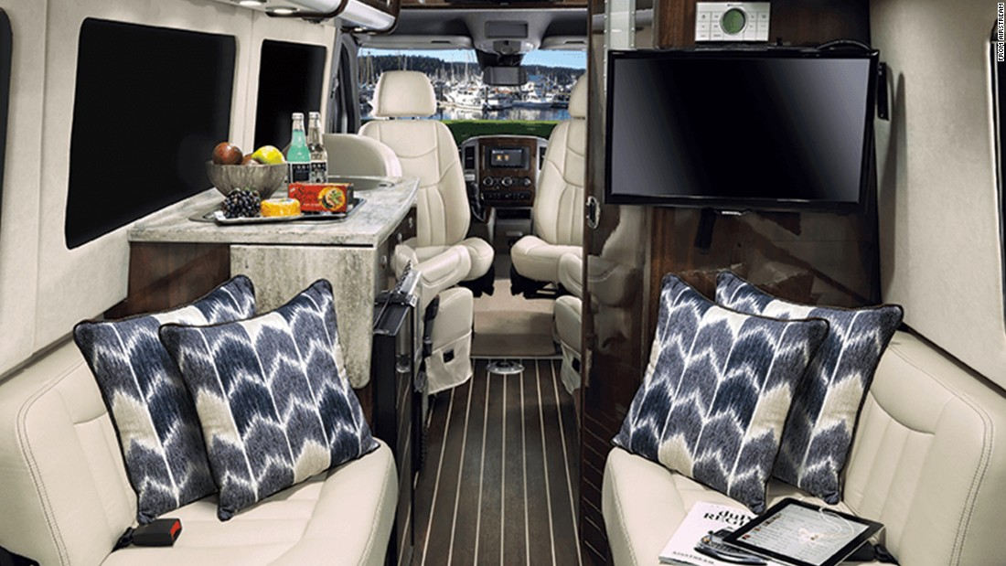 "For the tailgater that needs a bit of luxury, the <a href=""https://www.airstream.com/touring-coaches/lounge-ext/"" target=""_blank"">Airstream Interstate Lounge EXT</a> lets you travel to games with all the comforts of home -- TVs, couches and even the option to add beds."